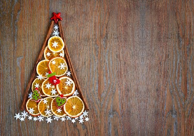 Christmas tree of orange slices, snowflakes and christmas decora