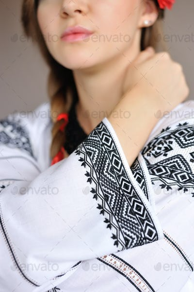 The girl in an embroidered shirt. Closeup detail of embroidered