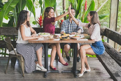group of four best friend having fun while lunch together at a c