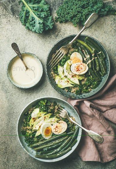 Healthy vegetarian protein rich breakfast bowls over grey concrete background