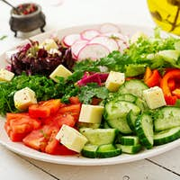Mix salad from fresh vegetables and greens herbs. Dietary menu. Proper nutrition. Healthy lifestyle.
