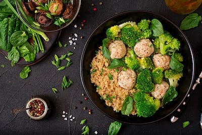 Baked meatballs of chicken fillet with garnish with quinoa and boiled broccoli