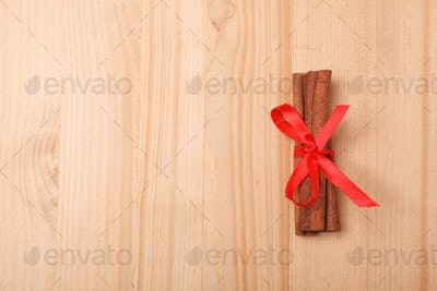 cinnamon bandaged with red ribbon