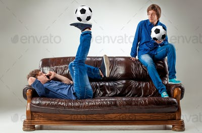 The two guys with balls on gray background