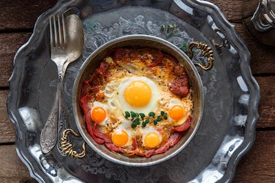 Top view of fried eggs with cured meat, turkish breakfast pastirmali yumurta