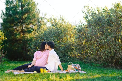 Happy couple having a healthy picnic on nature