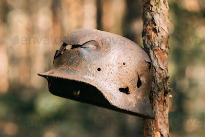 Damaged By Bullets And Shrapnel Metal Helmet Of German Infantry
