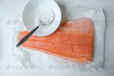Fillet of salmon fish on white table