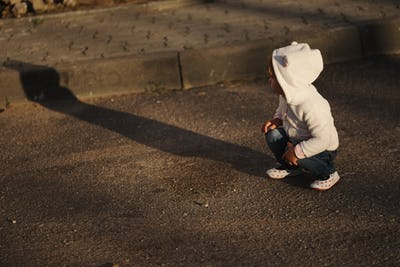 little girl with shadow outdoors