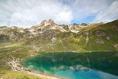 turquoise alpine lake in mountains
