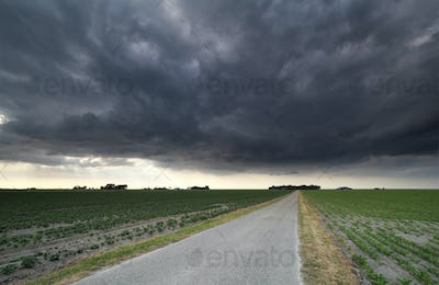 dark stormy sky over countryside road