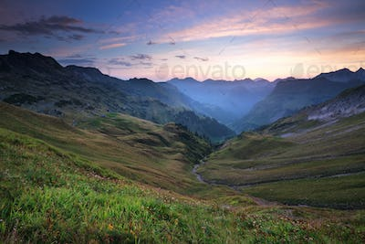 sunrise over beautiful mountains in summer