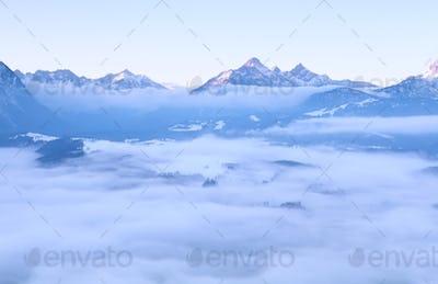 morning fog in winter Alps