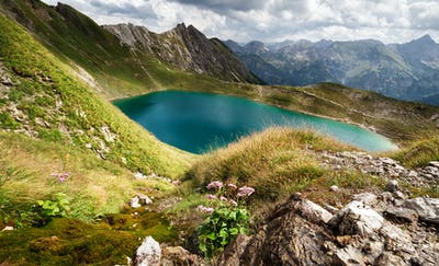 sunshine over turquoise alpine lake