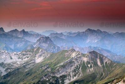 red sunrise over mountain peaks