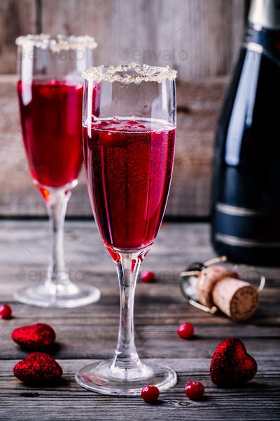 Refreshing cocktail with sparkling wine and cranberry for Valentine's day