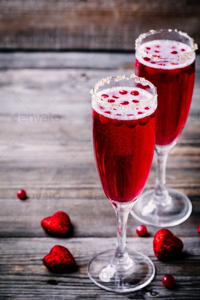 Refreshing cocktail with champagne and cranberry for Valentine's day
