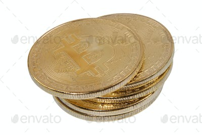 Gold Bitcoins on a white background
