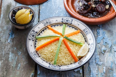 Moroccan couscous topped with vegetables. Rustic style.