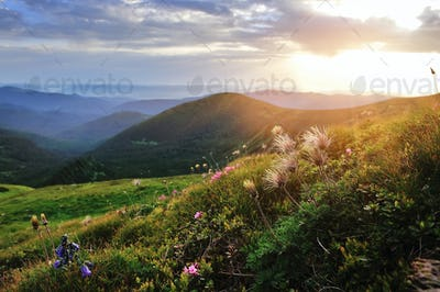 Magic sunset in the mountains landscape. Dramatic sky. Carpathia