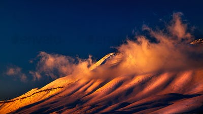 Beautiful sunset over snowy mountains