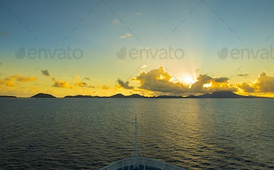 View of St Kitts and Nevis from the bow of a ship at dawn.