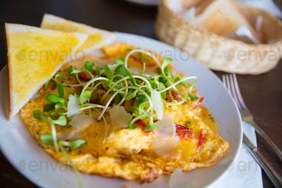 Spanish Omelette Served With Bread Slices On Table