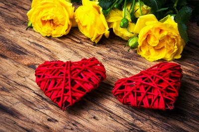 Spring flowers and symbolic red hearts