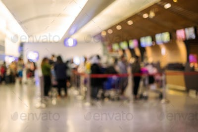 Blurred image of passengers wait in a queue for check-in in the airport