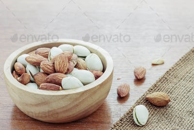 Almonds on wooden floor