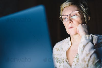 Middle-aged woman working on laptop