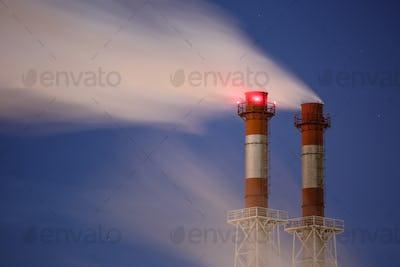 Stream of dark smoke from the chimney of factory