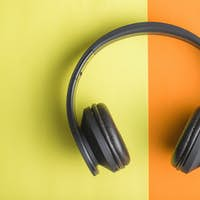 Headphones on double colorful background.