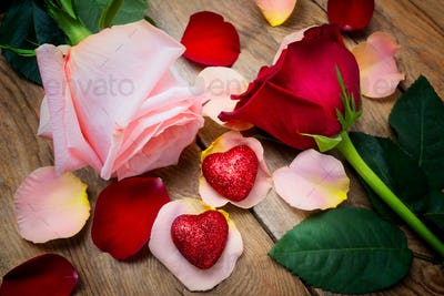 Valentines Day greeting with roses and two hearts on the  wooden