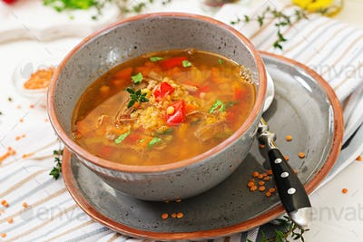 Appetizing soup with red lentils, meat, red paprika and fragrant thyme