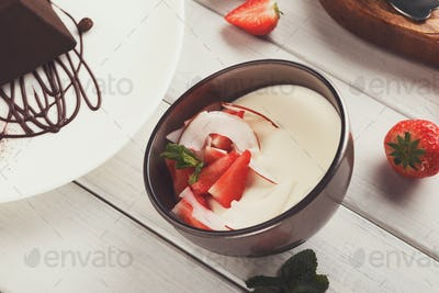 Coconut panna cotta with fresh strawberries