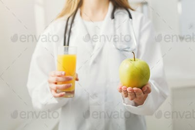 Unrecognizable nutritionist woman with fruit
