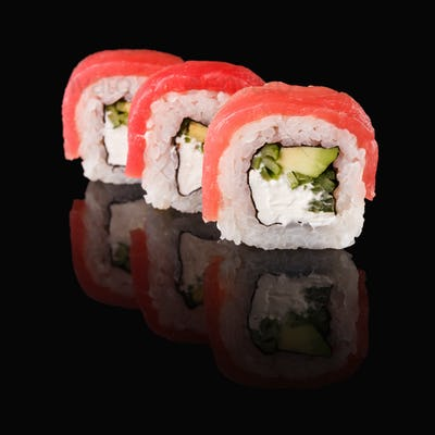 Japanese rolls on black mirroring background