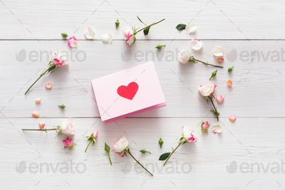 Valentine background with handmade paper with heart in pink rose flowers circle on white rustic wood