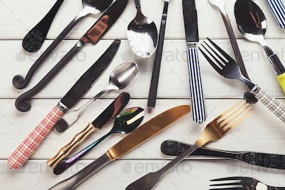Collection of modern and antique cutlery, top view