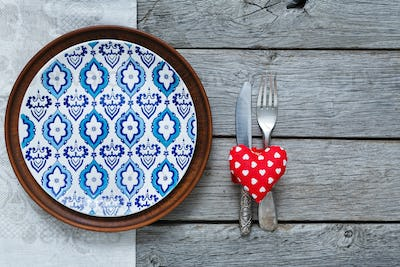 Valentine day background, cutlery, heart and plate with empty space