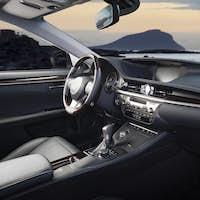 Car dashboard, modern luxury interior, steering wheel, sun rise in the windows