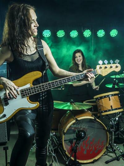 Beautiful women playing in the rock band