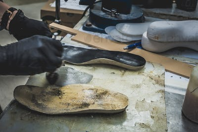 Adjusting an Orthotics Sole by Adding a Piece under the Arch