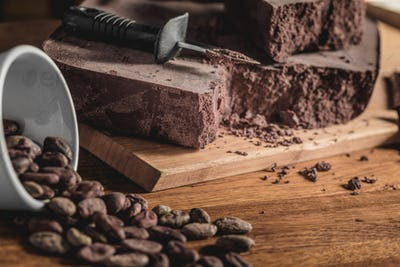 Sweet arrangement of cocoa beans and chocolate bars