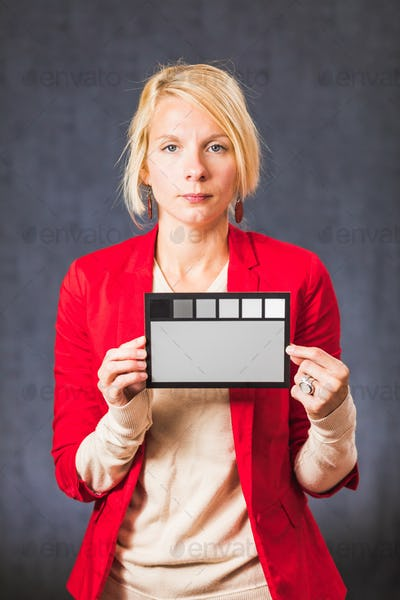 Woman holding gray color board