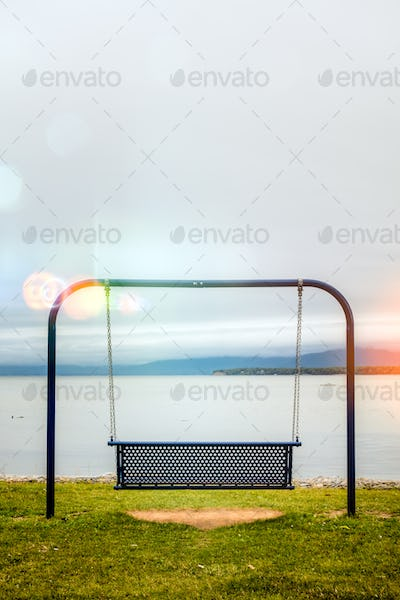 View to swings placed at ocean shore in Gaspe, New-Richmond, Que
