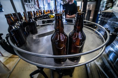 Line and bottles on microbrewery