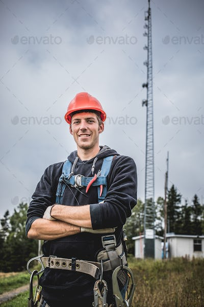 Smiling technician at telecom�tower