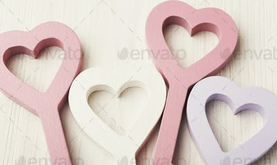 Happy Valentines Day background, key hearts. Copy space on wood
